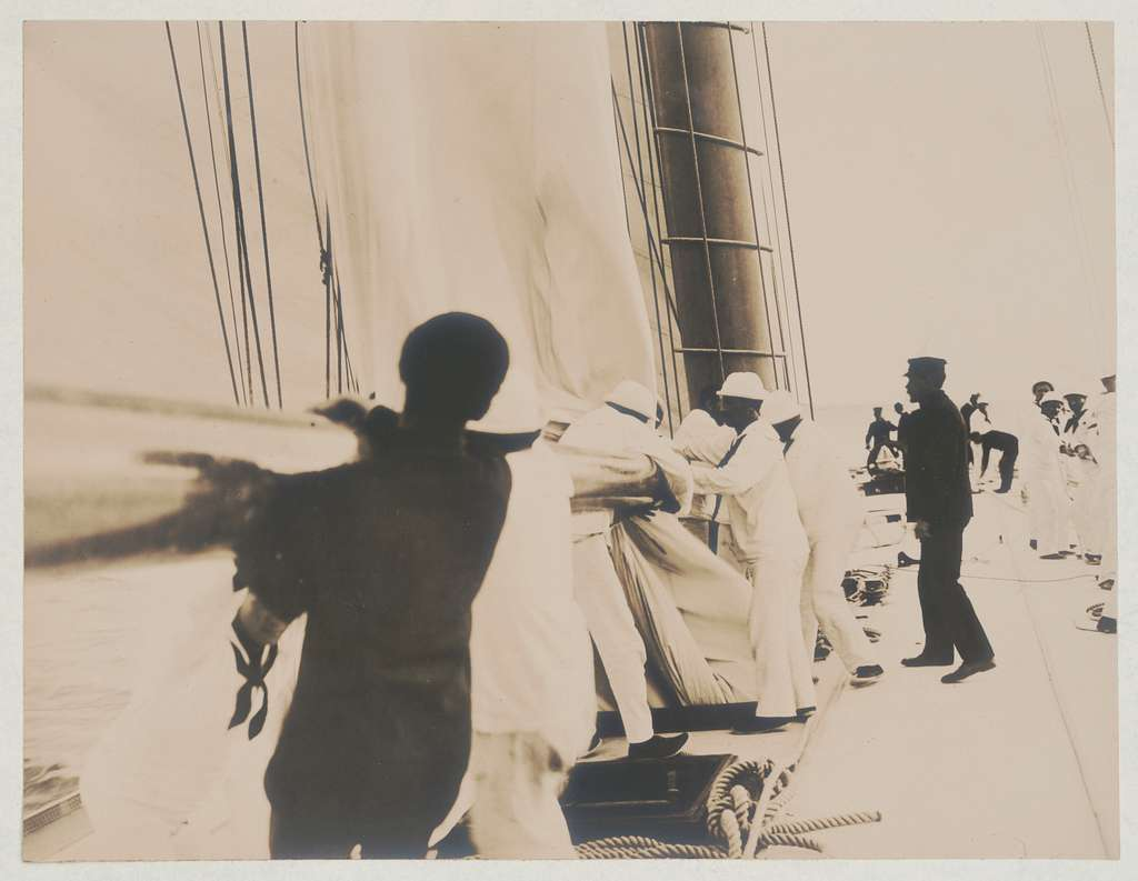 Crew handling sail on the yacht Reliance, winner of 1903 America's Cup