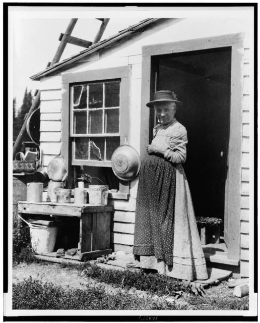 [Elderly woman, standing at doorway, on Mackinac Island, Michigan]