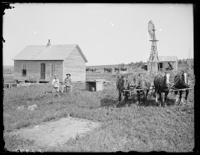 Elmer Drake and family in front of farmhouse, Sumner, Dawson County, Nebraska