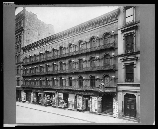 [Exterior view of the Boston Museum with shops on the street level, Boston, Massachusetts]