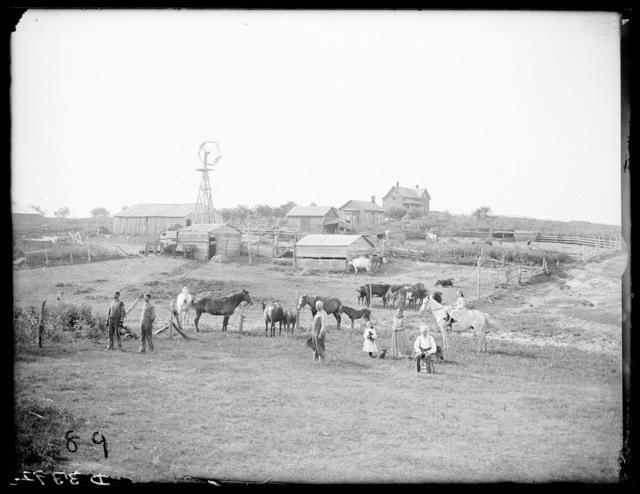 Family at John Weller's farm, Buffalo County, Nebraska.