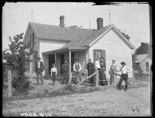 Family in front of Fred Albright's farm home, Buffalo County, Nebraska.