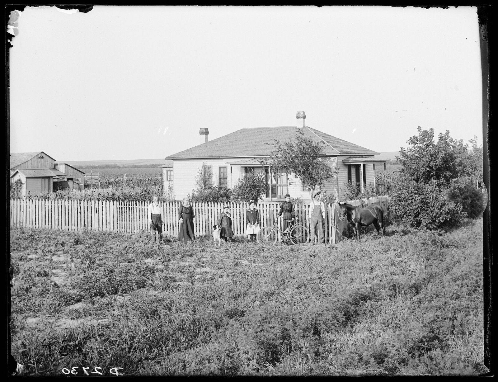 Family in front of the A.L. Fitch home, Watertown, Nebraska