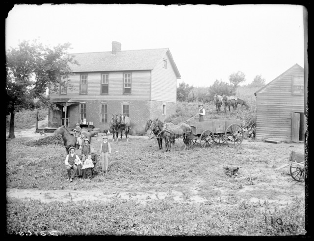 Family in front of the Carl Huffman farmhouse near Riverdale, Nebraska.
