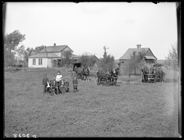 Family of J.W. Houser in front of their farm home, Buffalo County, Nebraska