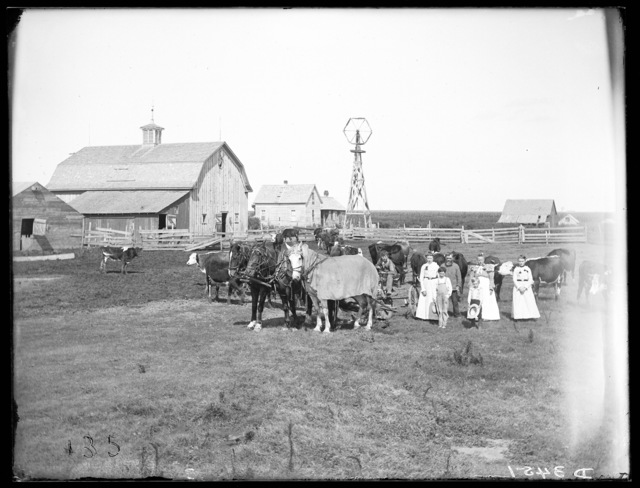 Family standing in the Chris Scheihing farmyard, Amherst, Buffalo County, Nebraska.
