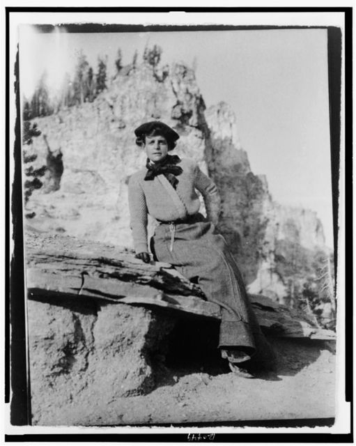 [Frances Benjamin Johnston, full-length portrait, seated on rock in Yellowstone National Park, facing front]