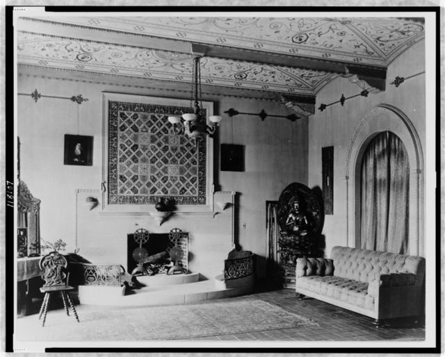[Interior of house designed by architect Jacques Benois Benedict, showing fireplace, sofa, art objects, etc., Denver, Colorado]