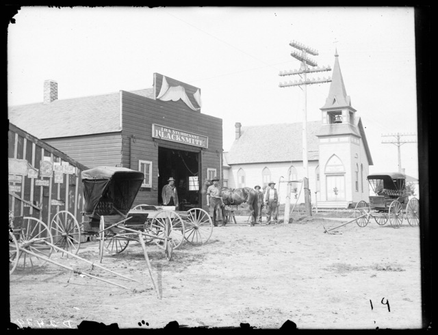 Ira Sturdevant Blacksmith Shop and First Baptist Church,  Broken Bow, Nebraska.