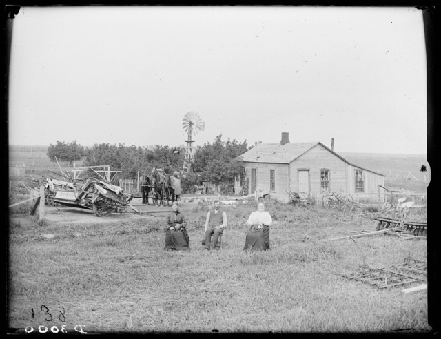 Jacob Anderson and family in front of their farmhouse, Kearney, Buffalo County, Nebraska