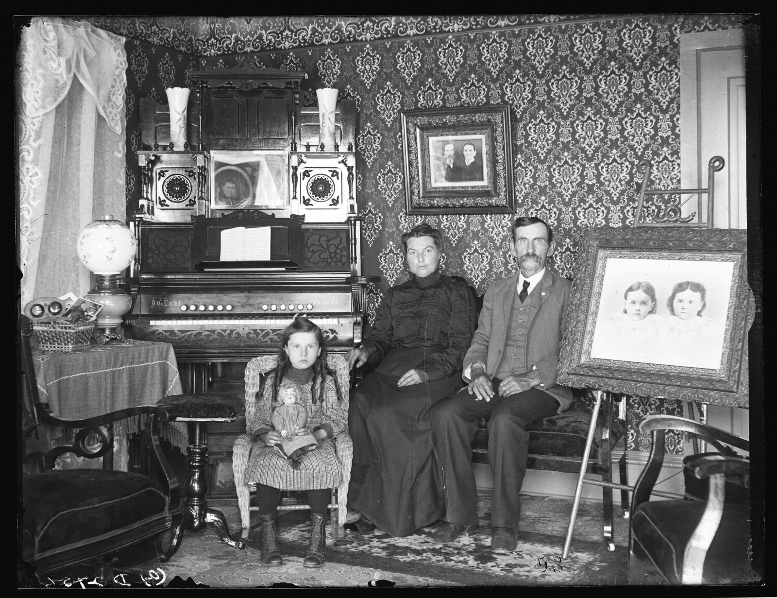 Mr. and Mrs. R.A. Acheson and their daughter in the living room of their farm house near Watertown, Nebraska.