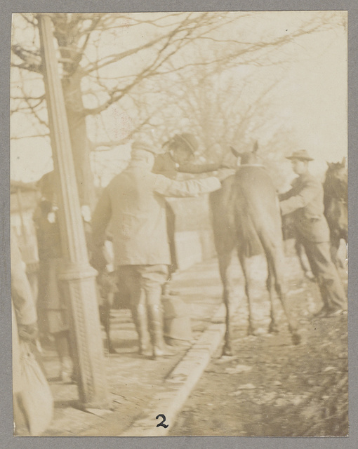 Mrs. Roosevelt assisted to mount by General Wood