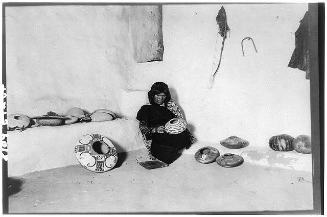 [Nampeyo, a noted Tewa Hopi potter of the Hano pueblo in northeastern Arizona, decorating pottery]