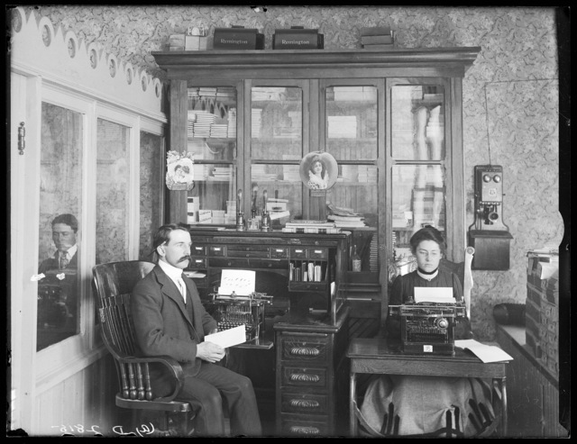 Portrait of Prof. C.W. Roush, principal of the Broken Bow Business College, and his stenographer, Miss Mable Holcomb.