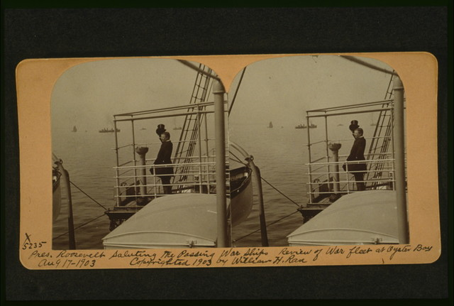 Pres. Roosevelt saluting the passing war ships, review of war fleet at Oyster Bay, Aug. 17, 1903