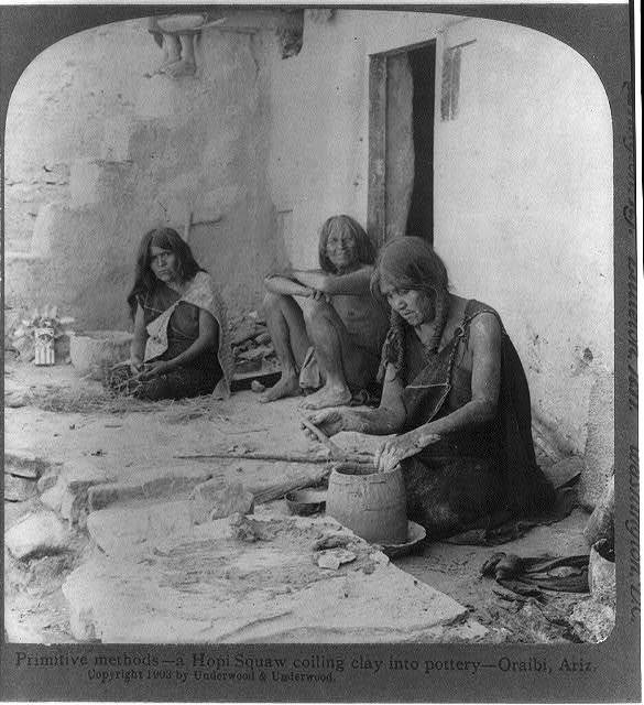 Primative methods-- a Hopi Squaw coiling clay into pottery, Oraibi, Ariz.