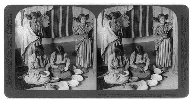 Primitive artists--Indian women decorating pottery, Hopi Reservation, Arizona
