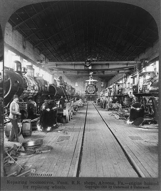 Repairing locomotives, Penn. R.R. shops, Altoona, Pa.--engine hoisted for replacing wheels