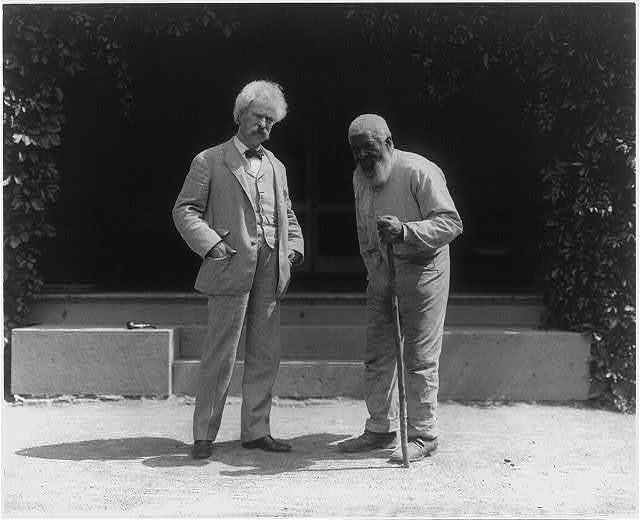 Samuel Clemens and John T. Lewis (an elderly African American man), both full length, standing