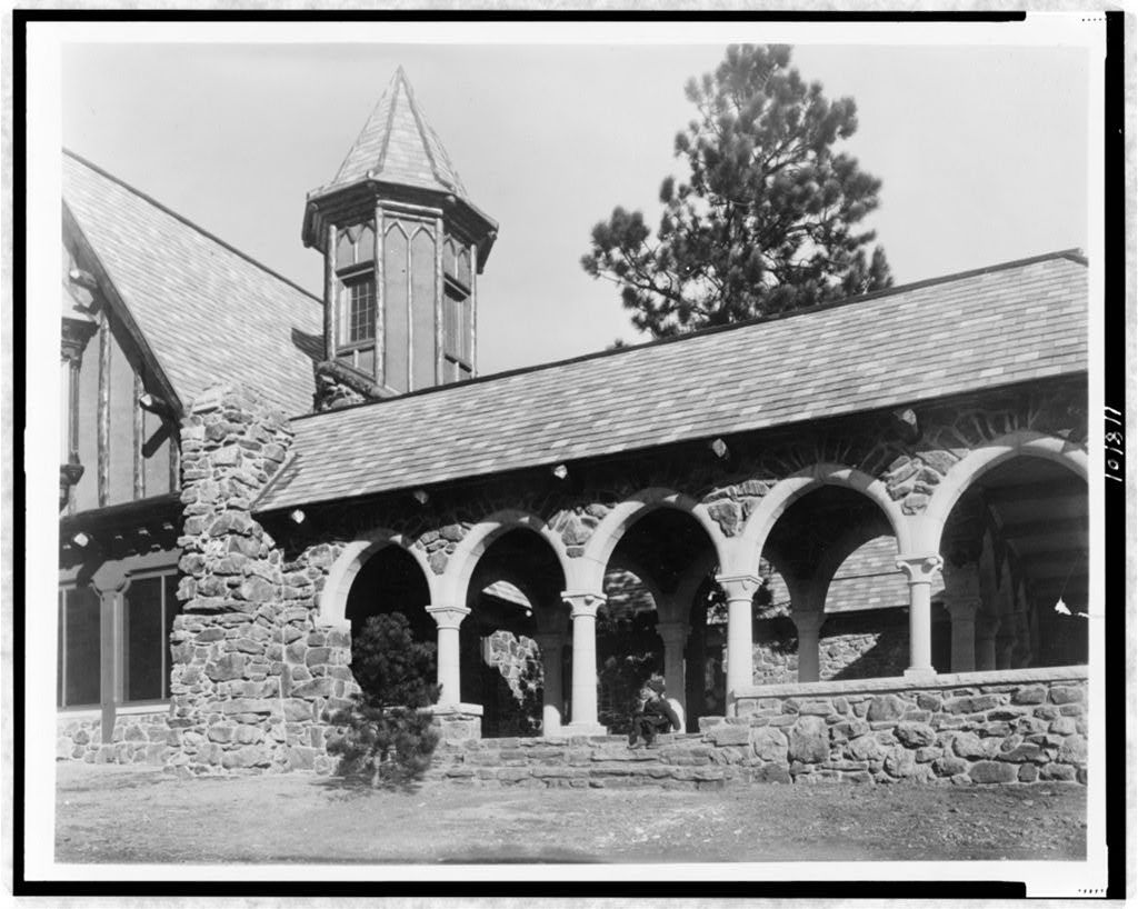 [Stone mountain lodge of Paul T. Mayo, Bear Creek Cañon, Rocky Mountains, Colorado, with boy seated on step, designed by architect Jacques Benois Benedict]