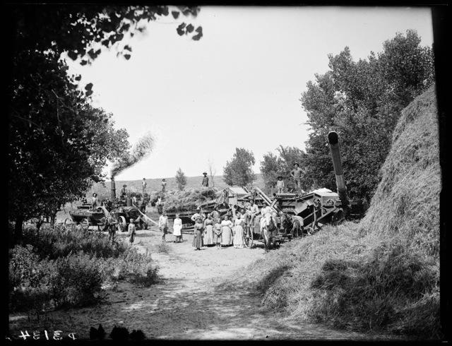 Threshing crew and women shown on farm of W. Baker, Riverdale, Nebraska.