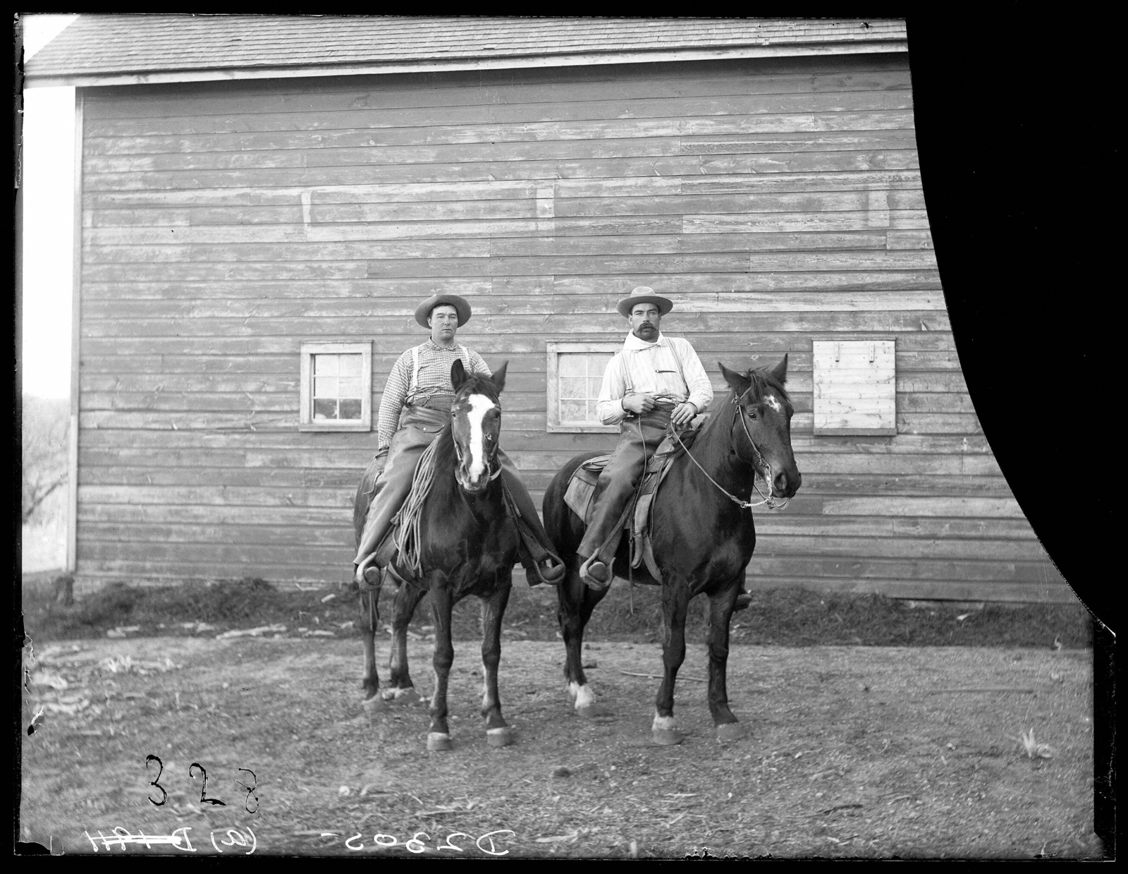 Two cowboys on the Lou Hammer Ranch near Wood River, Hall County, Nebraska