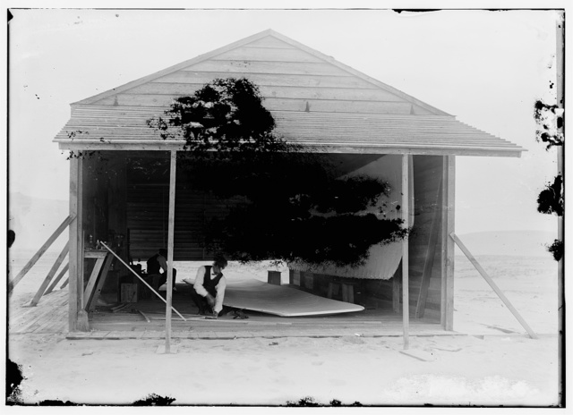 [Wilbur and Orville assembling the 1903 machine in the new camp building at Kill Devil Hills. Kitty Hawk, North Carolina]