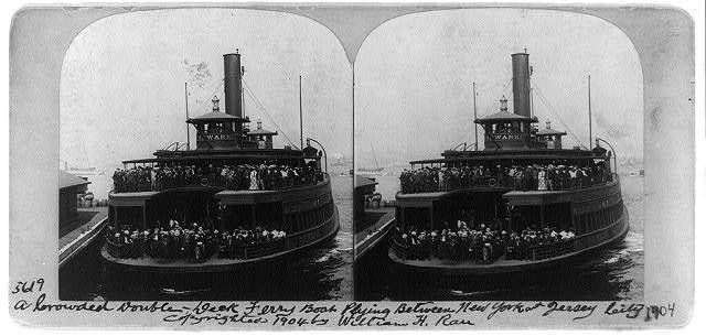 A crowded double-deck ferry boat plying between New York and Jersey City