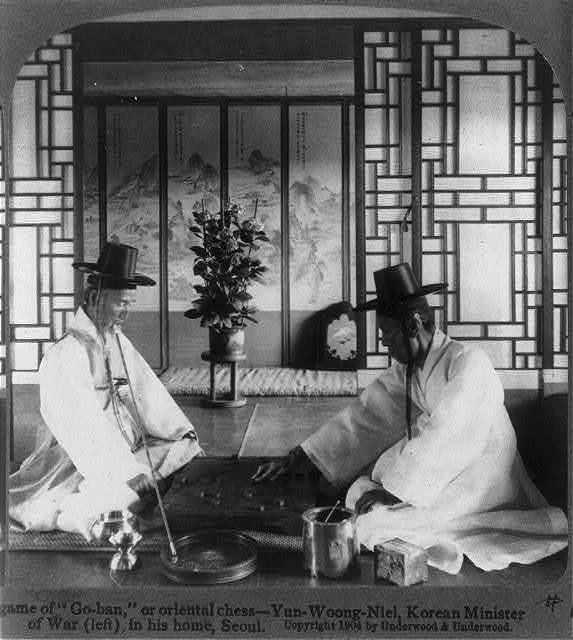 """A game of """"Go-ban,"""" or oriental chess - Yun-Woong-Niel, Korean Minister of War (left) in his home, Seoul"""