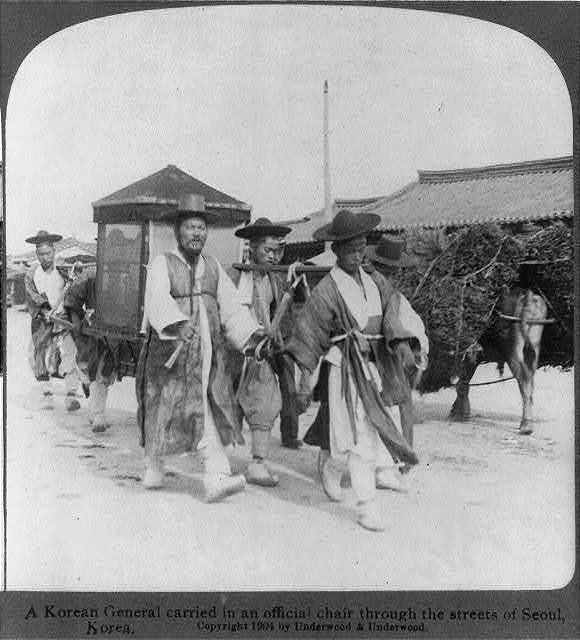 A Korean General carried in an official chair through the streets of Seoul, Korea