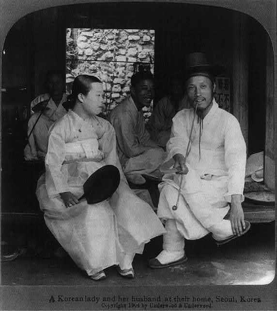 A Korean lady and her husband at their home, Seoul, Korea