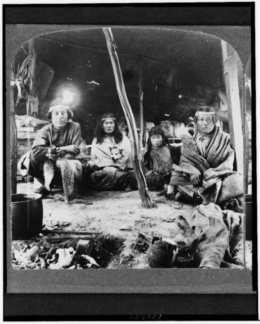 A typical group of Patagonians under their sheepskin tent - a race of South American giants, World's Fair, St. Louis, U.S.A. / International View Co., photographers and publishers, Decatur, Illinois.