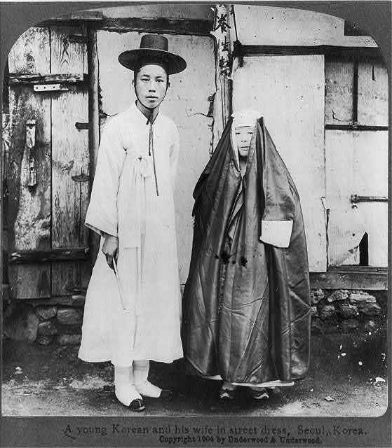 A young Korean and his wife in street dress, Seoul, Korea