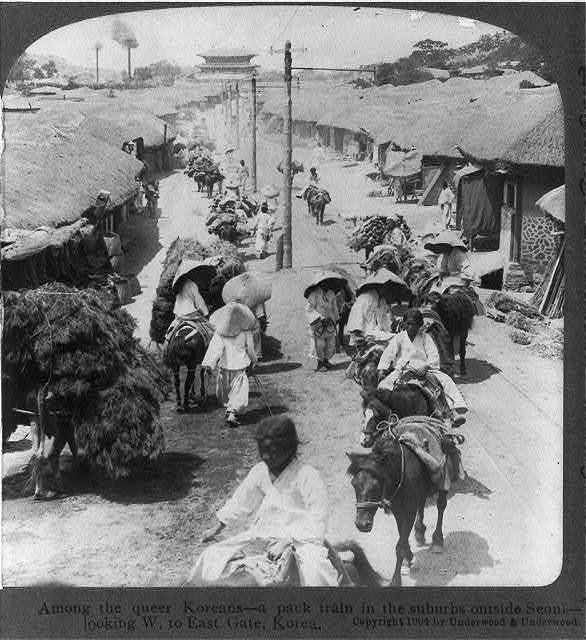 Among the queer Koreans - a pack train in the suburbs outside Seoul - looking W. to East Gate, Korea
