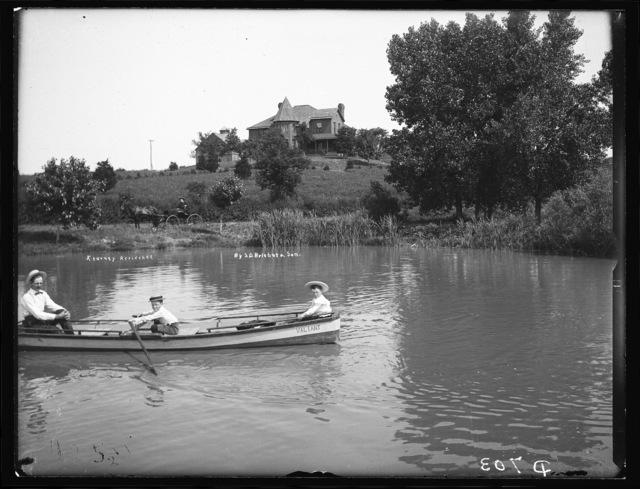 Boating near the C.B. Reynolds residence at Kearney, Nebraska