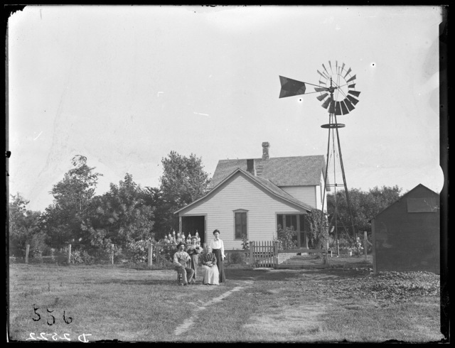 Charles Smith and family in front of their home, Lexington, Nebraska.