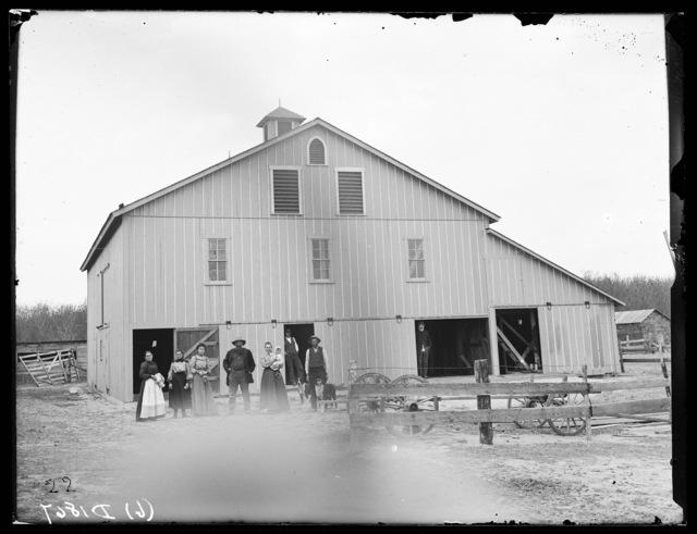 David Christensen and family in front of their barn,. New Helena, Nebraska.