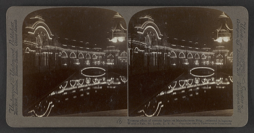 Evening effect of electric lights on Manufacturers Bldg., reflected in lagoon - World's Fair,  St. Louis,  U.S.A.