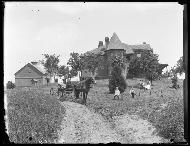 Family in front of C.B. Reynold residence, Kearney, Nebraska.