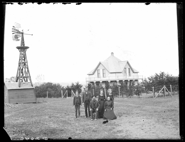 Family in front of Ole Johnson's new house, Round Valley, Custer County, Nebraska
