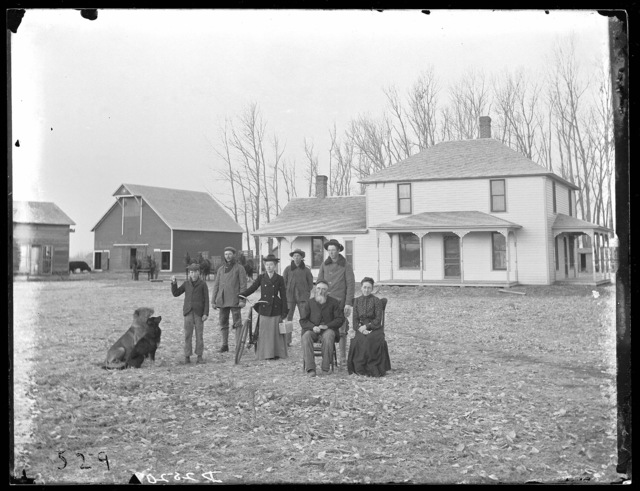 Family of William Vasey in front of their home, Cozad, Nebraska.