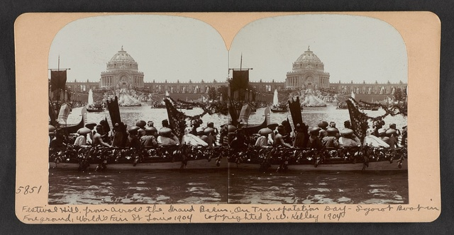 Festival Hill from across the Grand Basin on Transportation Day, Igorot boat in foreground, World's Fair, St. Louis, 1904