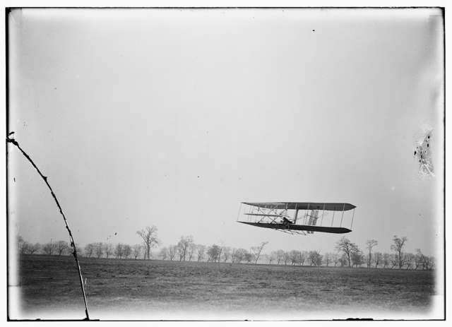 [Flight 85: Orville in flight over treetops, covering a distance of approximately 1,760 feet in 40 1/5 seconds; Huffman Prairie, Dayton, Ohio]