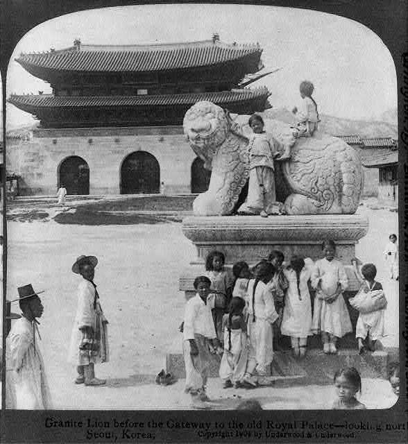 Granite lion before the gateway to the old Royal Palace - looking north - Seoul, Korea