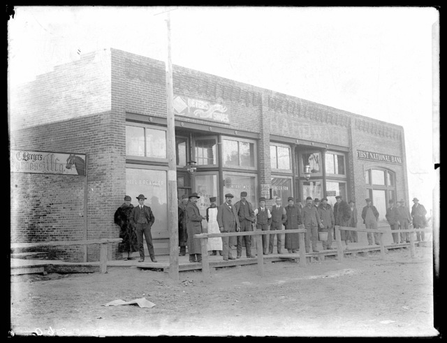 Group of people gathered at the First National Bank, Overton, Nebraska