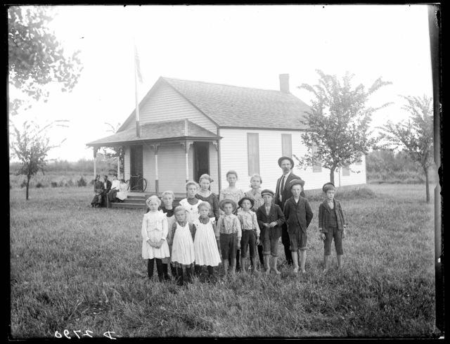 Group of students and teachers on the yard at the Watson Ranch School, Buffalo County, Nebraska