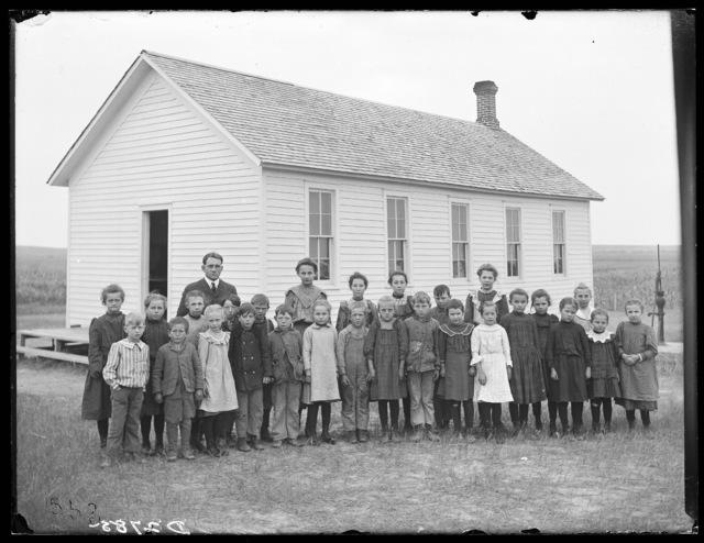 Group of students and tehir teacher in front of a school building in Lexington, Nebraska.