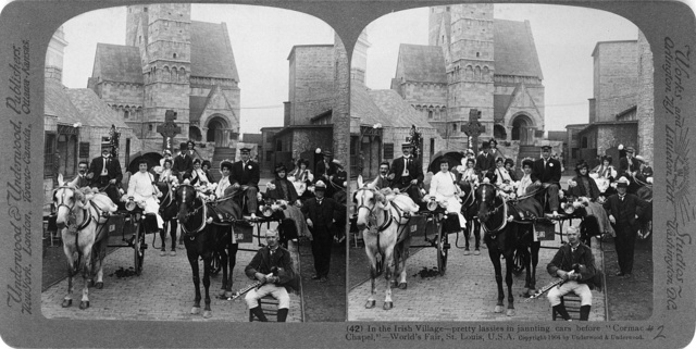 """In the Irish village--pretty lassies in jaunting cars before """"Cormac Chapel"""",--World's Fair, St. Louis, U.S.A."""
