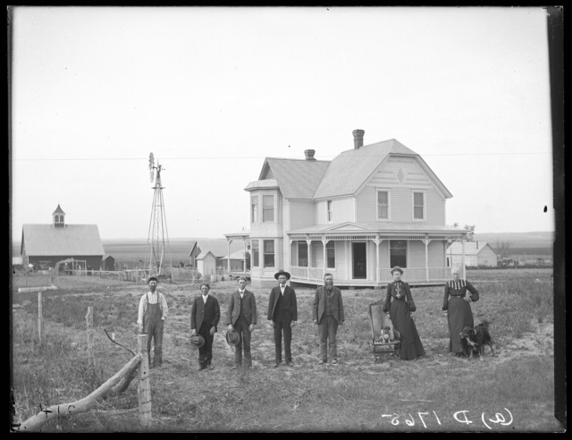 James Wood and family in front of their new house, Dale Valley, Nebraska.