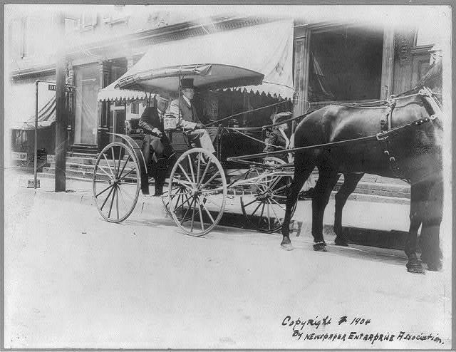 [John Davison Rockefeller, 1839-1937, seated in back of horse-drawn carriage]